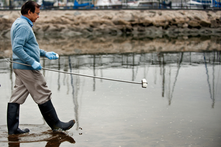 Pravin Patel, a lab technician in the Environmental Monitoring Division for Los Angeles County, takes samples of the beach water in Marina del Rey on Monday, Aug. 5.