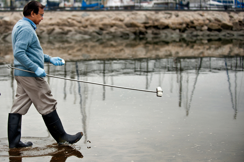 Lab Technician Pravin Patel takes water quality samples from Mother's Beach in Marina del Rey. This year's Beach Report Card from Heal the Bay, citing poor water circulation, ranks Mother's Beach as the worst in Southern California.