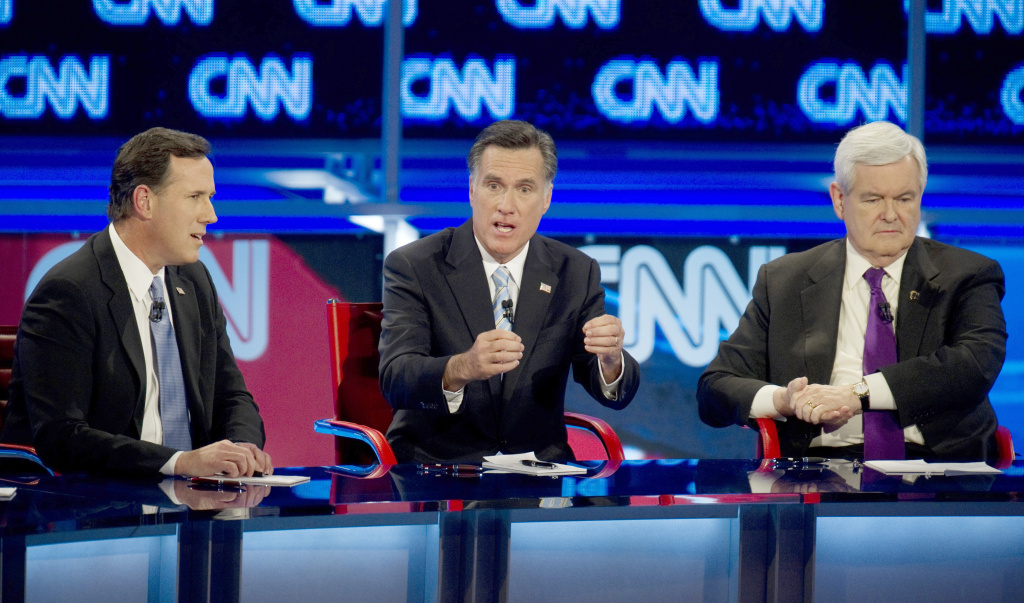 Republican presidential candidates Rick Santorum (L), Mitt Romney (C) and Newt Gingrich debate on February 22, 2012 in Mesa, Arizona. The Arizona and Michigan primaries are scheduled to be held February 28.    AFP PHOTO/DON EMMERT (Photo credit should read DON EMMERT/AFP/Getty Images)