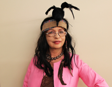 "Patt Morrison models a headdress from the movie ""The Lone Ranger."""