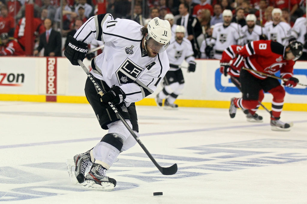 Anze Kopitar #11 of the Los Angeles Kings skates up ice with the puck before scoring the game winning goal in overtime against the New Jersey Devils during Game One of the 2012 NHL Stanley Cup Final at the Prudential Center on May 30, 2012 in Newark, New Jersey.