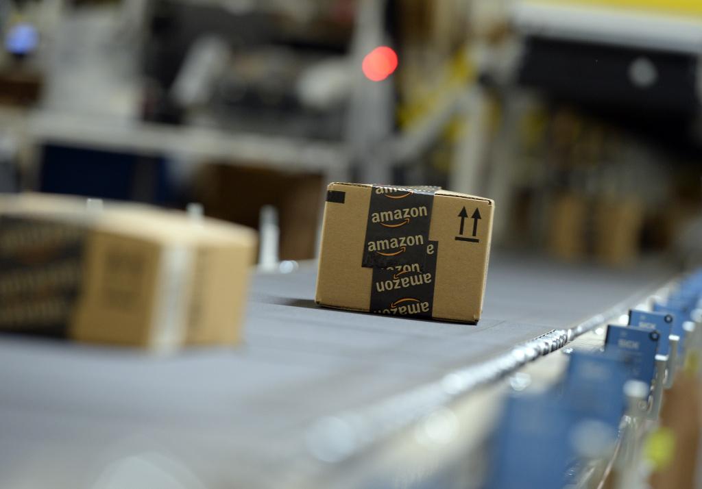 Shipping orders go by on a conveyor belt at Amazon's San Bernardino Fulfillment Center October 29, 2013 in San Bernardino, California.
