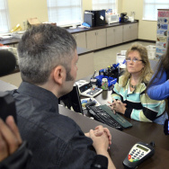 Rowan County Clerk Kim Davis (right) talks with David Moore on Tuesday morning following her refusal to issue a marriage license to him and his partner at the Rowan County Courthouse in Morehead, Ky.