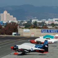 Neighbors of Santa Monica Airport have complained about noise from the aircraft taking off and landing, and they post signs asking pilots to fly quietly.
