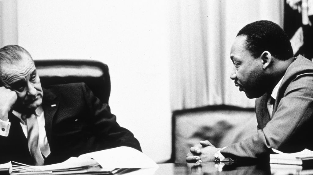 President Lyndon Johnson and civil rights leader Martin Luther King Jr. discuss the Voting Rights Act in 1965. On Wednesday, the Supreme Court hears arguments on whether a key part of the law is still needed nearly a half century after its passage.