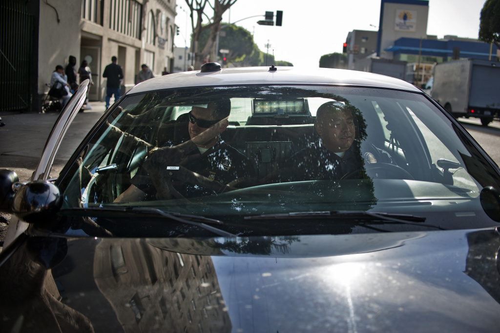 File: LAPD Officers William Allen, left, and Guillermo Espinoza get into their patrol car after doing a foot patrol in Skid Row.