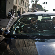LAPD Officers William Allen, left, and Guillermo Espinoza get into their patrol car after doing a foot patrol in Skid Row.