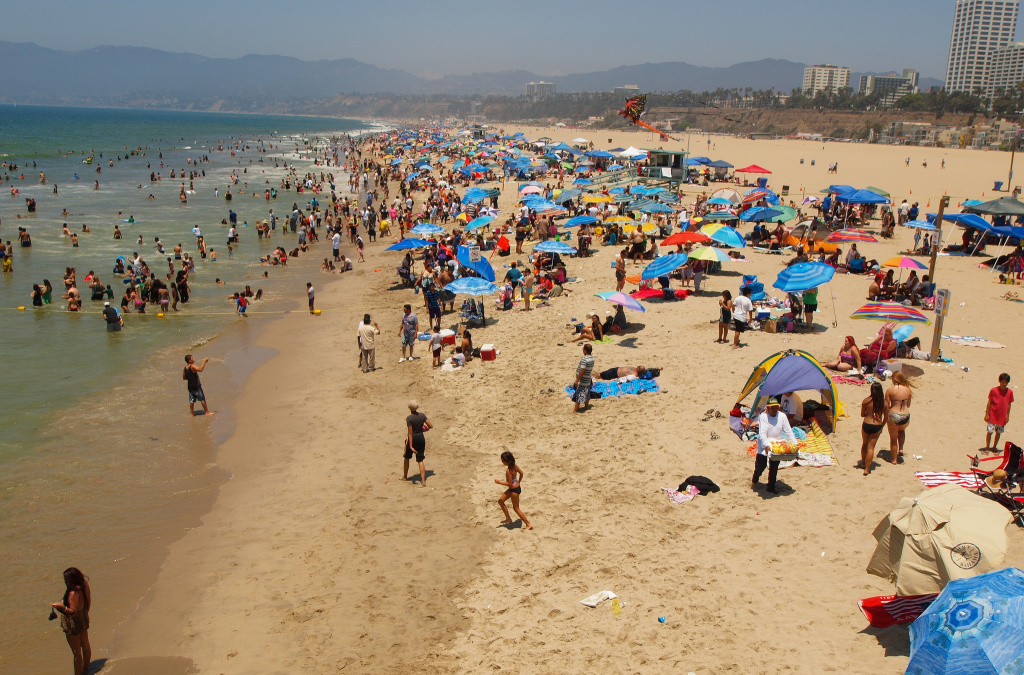 File: A hot day with people on the beach in Santa Monica.
