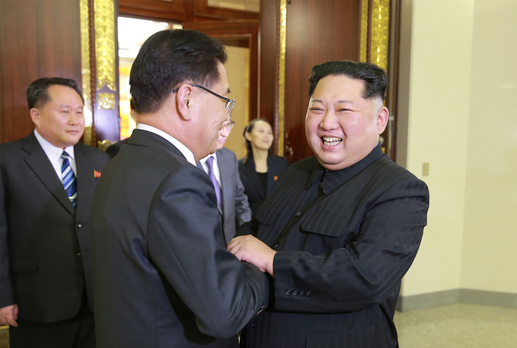 This picture taken on March 5, 2018 and released from North Korea's official Korean Central News Agency (KCNA) on March 6, 2018 shows North Korean leader Kim Jong-Un (R) shaking hands with South Korean chief delegator Chung Eui-yong (C), who travelled as envoys of the South's President Moon Jae-in, during their meeting in Pyongyang.