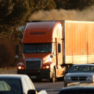 Diesel smoke spews from a truck as morning commuters travel the 210 freeway near Pasadena in Los Angeles County. A federal judge has dismissed a trucking association's lawsuit against new rules intended to reduce truck and bus pollution in California. (Photo by David McNew/Getty Images)
