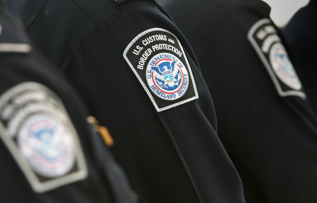 Officers with the U.S. Customs and Border Protection line up in the International Arrivals terminal of Newark International Airport Aug. 24, 2009 in Newark, New Jersey.