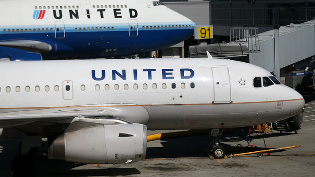United Airlines jets lined up on the San Francisco International Airport tarmac. A flight was diverted to Los Angeles on Wednesday.