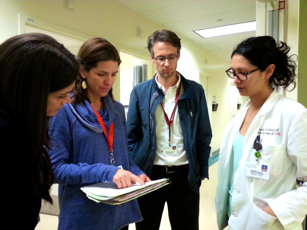 Psychiatrist Emily Dossett, second from left, runs the Mental Health Wellness program at L.A. County-USC Medical Center's OB clinic.