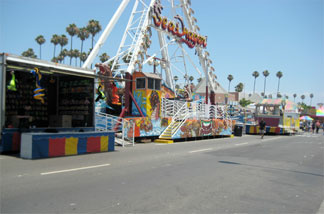 The carnival rides sit idle shortly after the event's opening.