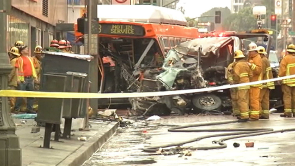 A tow truck crashed into a 7-Eleven store in downtown Los Angeles after colliding with a bus.