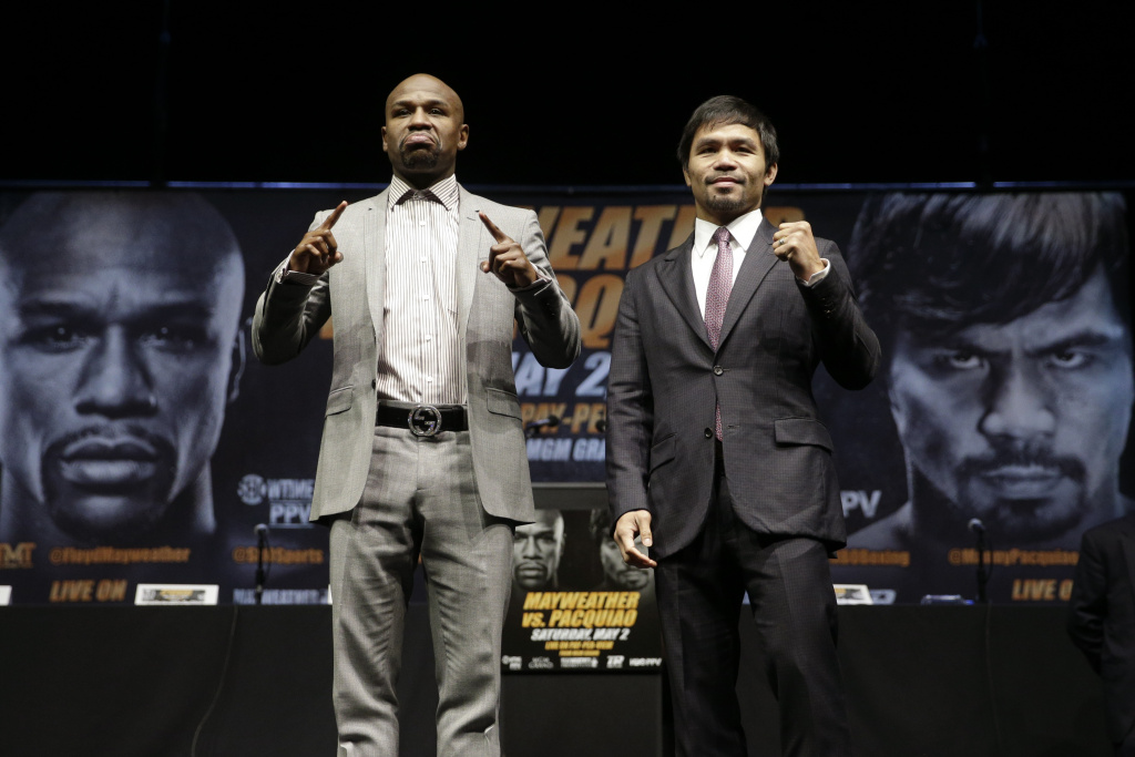 Boxers Floyd Mayweather Jr., left, and Manny Pacquiao, of the Philippines, pose for photos after a news conference, Wednesday, March 11, 2015, in Los Angeles. The two are scheduled to fight in Las Vegas on May 2. (AP Photo/Jae C. Hong)