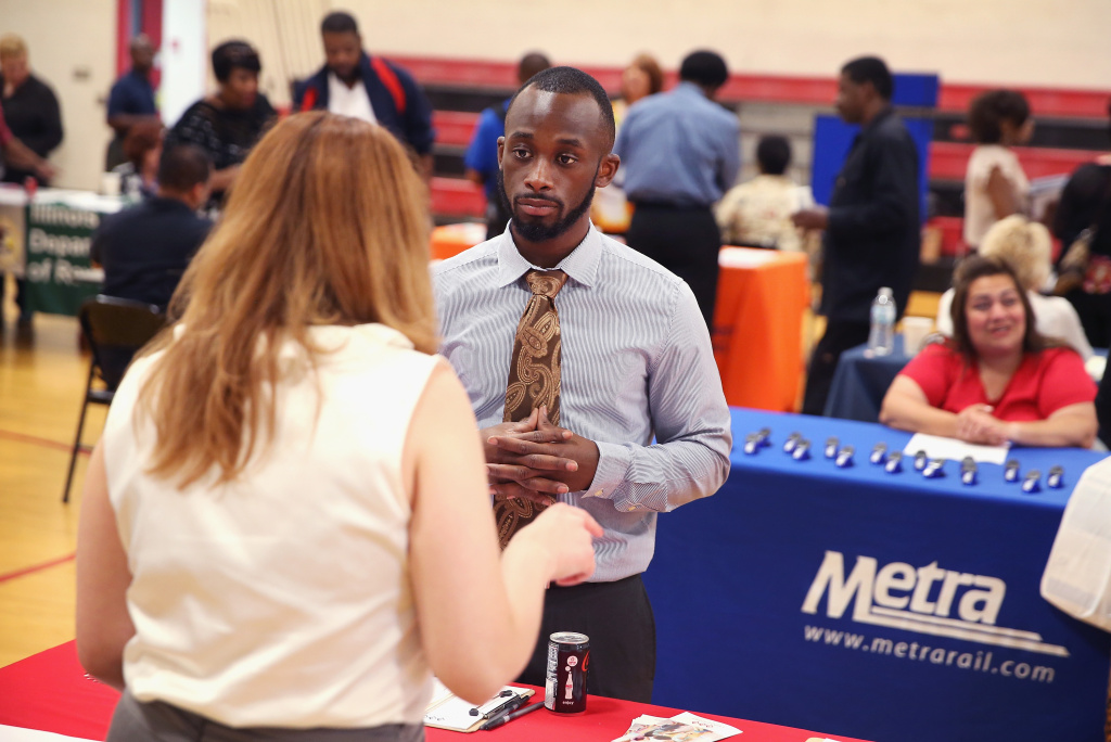 Darias Brown speaks to a recruiter at a job fair on June 12, 2014 in Chicago, Illinois. According to the Department of Labor's latest jobs report unemployment is at 6.3%, the lowest since 2008 when massive layoffs swept through the country.