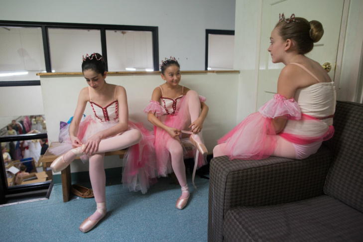 An instructor gets her student ready for a Nutcracker rehearsal at Westside Ballet in Santa Monica, Calif. This year the show went on despite the absence of the school's founder, Yvonne Mounsey.