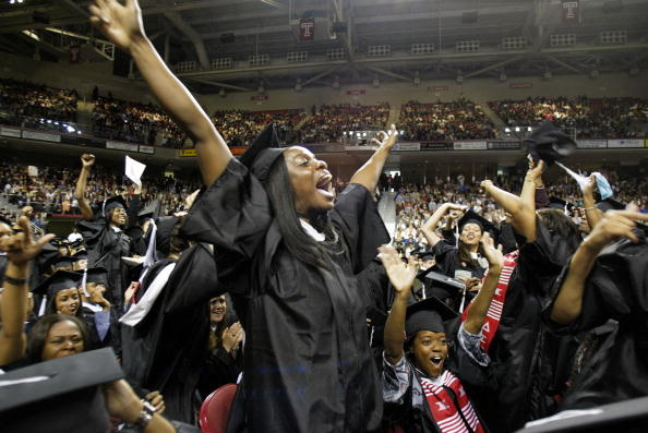 Enewan Adjah of Piscataway, NJ celebrates receiving her degree in Public Relations as graduates of the Class of 2003 at Temple University's commencement ceremony in The Liacouras Center May 22, 2003 in Philadelphia, Pennsylvania.
