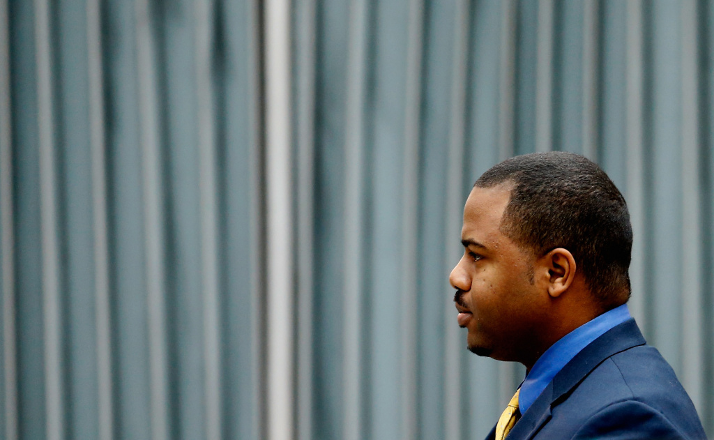 File: William Porter, one of six Baltimore city police officers charged in connection to the death of Freddie Gray earlier in the year, walks to a courthouse for jury selection in his trial on Nov. 30, 2015 in Baltimore, Maryland.