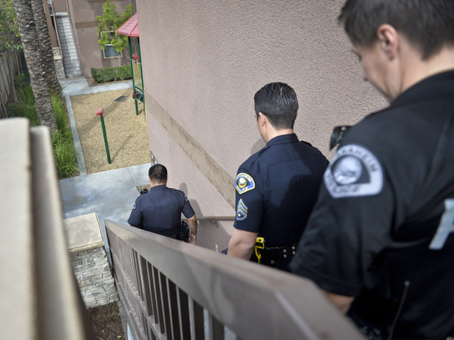 Anaheim Police Department CPT officers patrol an apartment complex in Anaheim Thursday after hearing yelling from one of the units. 