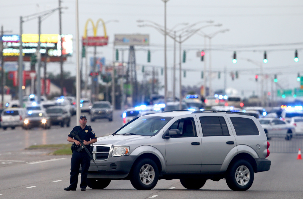 BATON ROUGE, LA - JULY 17: An East Baton Rouge Police officer patrols Airline Hwy after 3 police officers were killed early this morning on July 17, 2016 in Baton Rouge, Louisiana. According to reports, one suspect has been killed while others are still being sought by police.  (Photo by Sean Gardner/Getty Images)