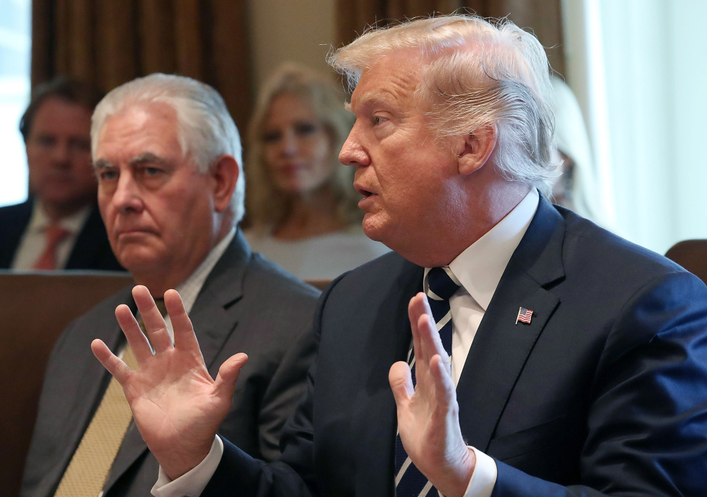 U.S. President Donald Trump (R), joined by U.S. Secretary of State Rex Tillerson speaks to the media during a meeting with his cabinet at the White House on October 16, 2017 in Washington, DC.