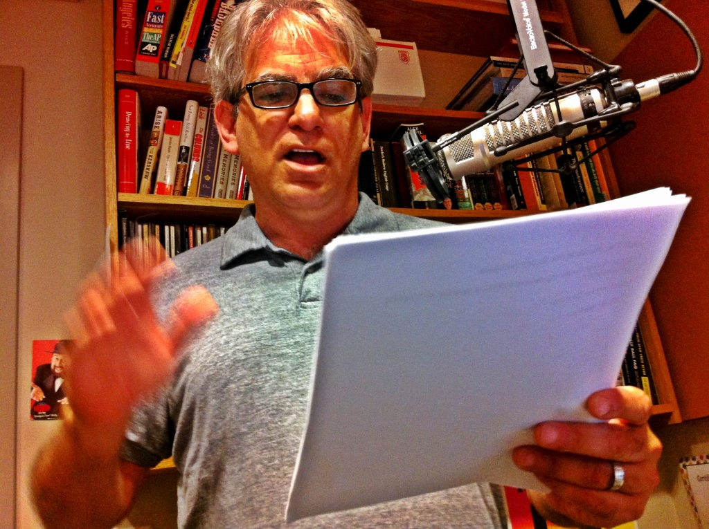Commentator Dylan Brody reading a radio script in the Off-Ramp studio.