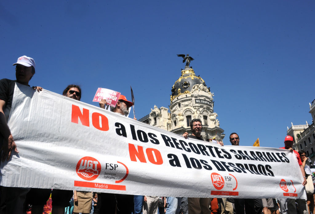 Government employees demonstrate against the Spanish government's latest austerity measures, in Madrid on July 20. The measures, which include a tax increase and a cut to unemployment benefits, are an attempt by the Spanish government to lower a debt of about 80 billion dollars.