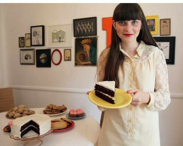 Clara Polito holds a slice of homemade cake in her dining room.