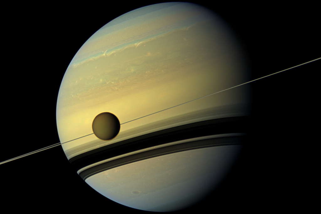 Saturn, with Titan in the foreground, as observed by the Cassini spacecraft on May 6, 2012.