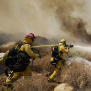 Firefighters battle a wildfire in Cabazon, Calif.