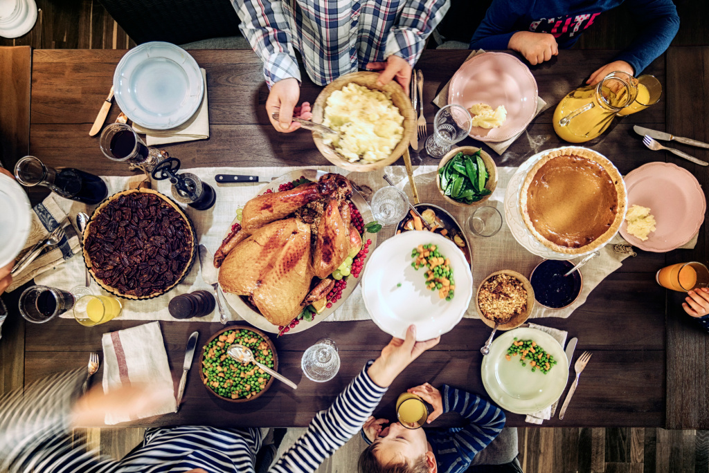 A traditional Thanksgiving meal at a dinner table — the setting for a potential conversational battle.