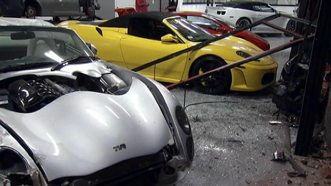 A TVR Tuscan and a yellow Ferrari are seen damaged inside Specialty Craft Car on South La Cienega Boulevard.