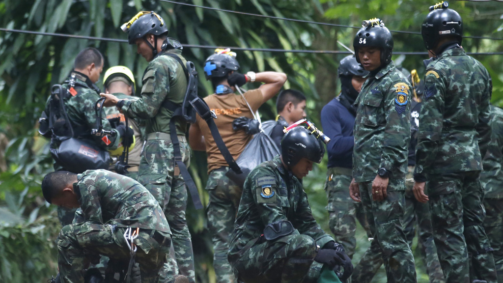 Thai rescuers prepare to enter the cave where 12 boys and their soccer coach have been trapped  in Chiang Rai province, in northern Thailand Friday. A Thai diver died while on a supply mission.