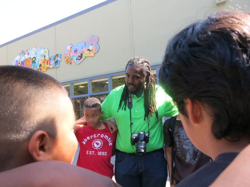 Ashanti Branch, an assistant principal at Montera Middle School in Oakland, Calif., leads boys in a
