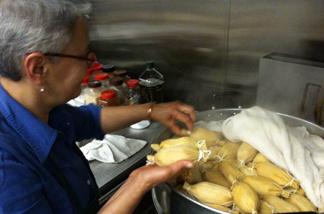 Patricia Zarate, manager of Homegirl Cafe, readies a batch of tamales. The L.A. restaurant is set to sell artisan tamales at a new LAX restaurant in a few months.