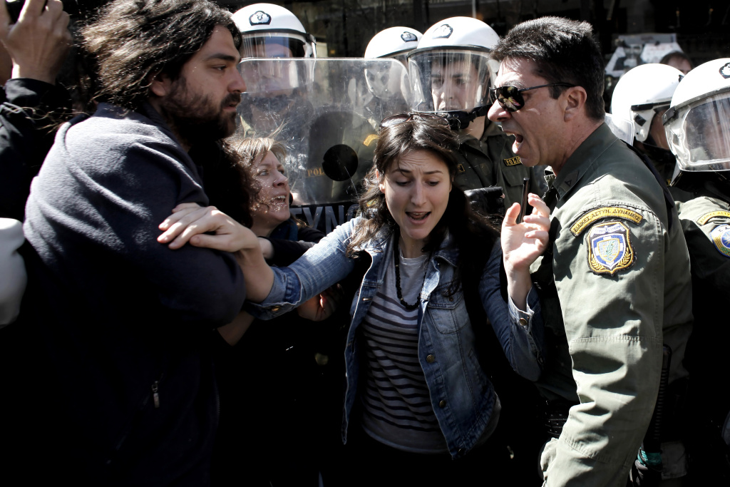Protestors scuffle with riot police during Greek Independence Day in Athens on March 24, 2012.
