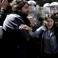 Protestors scuffle with riot police duri