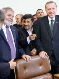 Brazilian President Luiz Inacio Lula da Silva, and Turkish Prime Minister Recep Tayyip Erdogan (R) smile as Iranian President Mahmoud Ahmadinejad (C) talks to Brazil's Foreign Minister Celso Amorim after Iran inked a nuclear fuel swap deal in Tehran in 2010.  Iran's nuclear chief said Wednesday his country has begun installing a new generation of uranium enrichment centrifuges at its main facility making nuclear fuel.