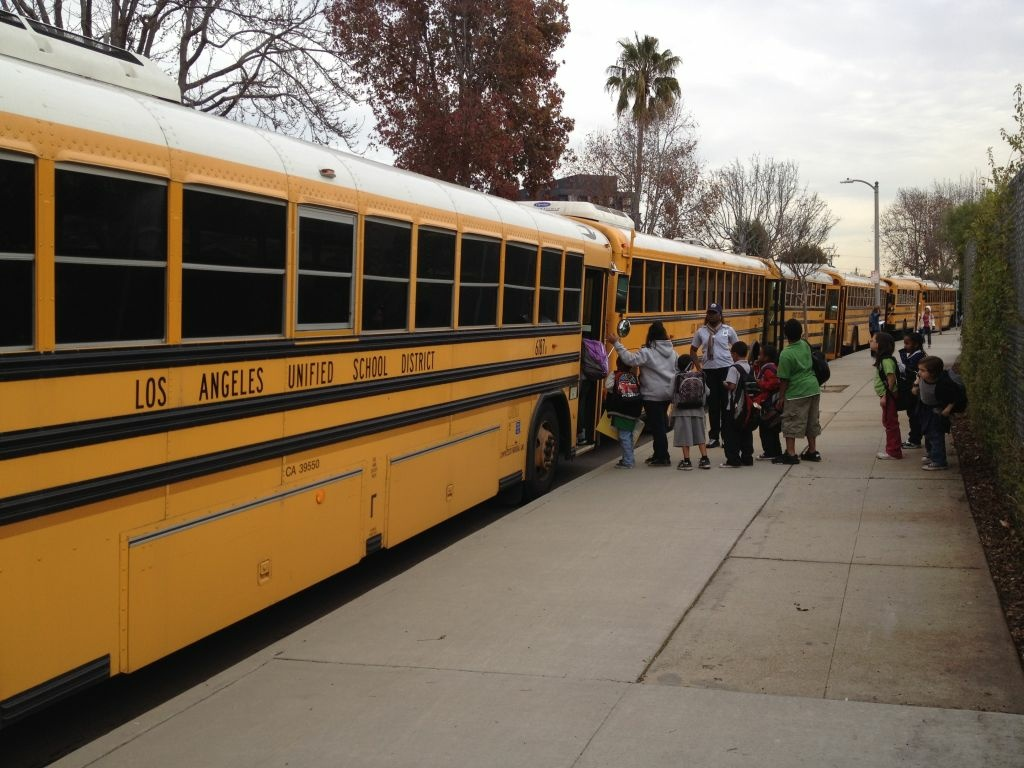 Students leaving school on a bus.