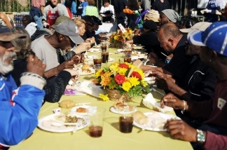 Homeless people eat a Thanksgiving lunch for the homeless in downtown Los Angeles.