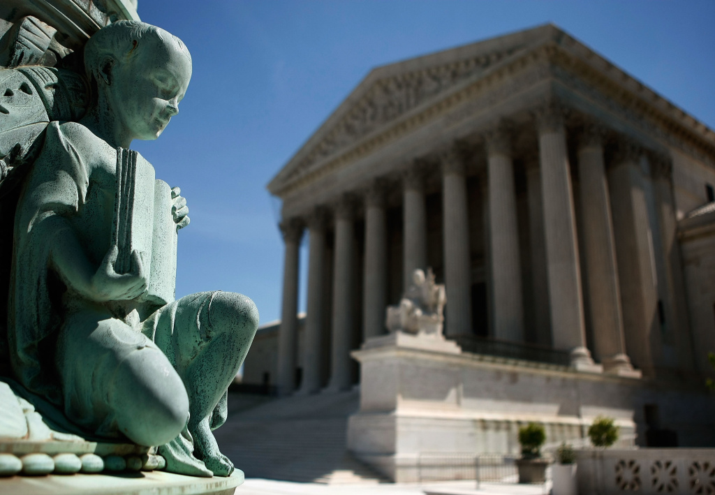 A statue sits on a flag pole in front of the U.S. Supreme Court in Washington. The high court is likely entering a new, more conservative era.