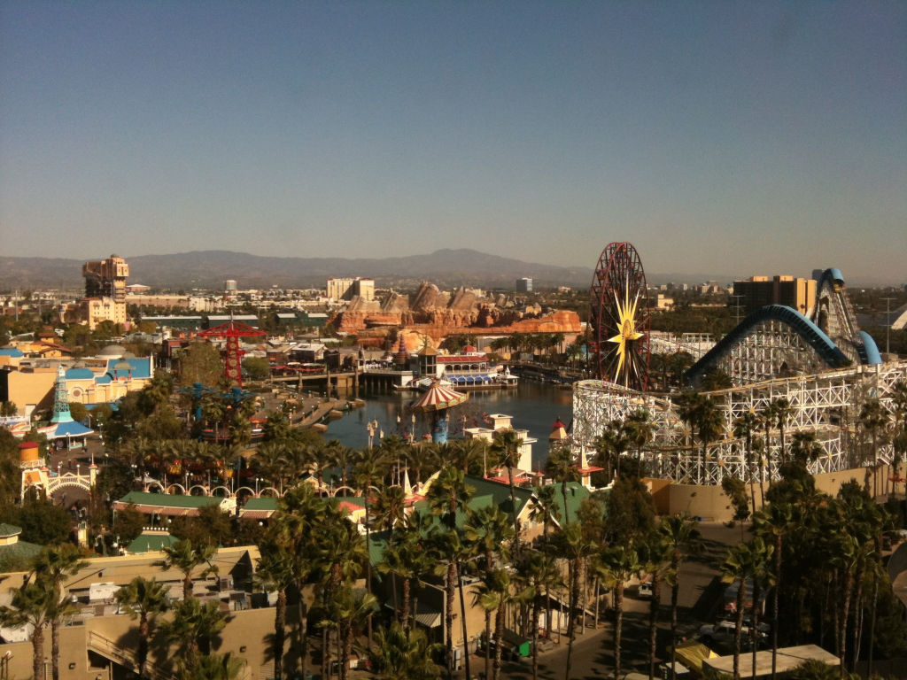 The red rocks of Disney California Adventure's new Cars Land are visible beyond the water in the photo.