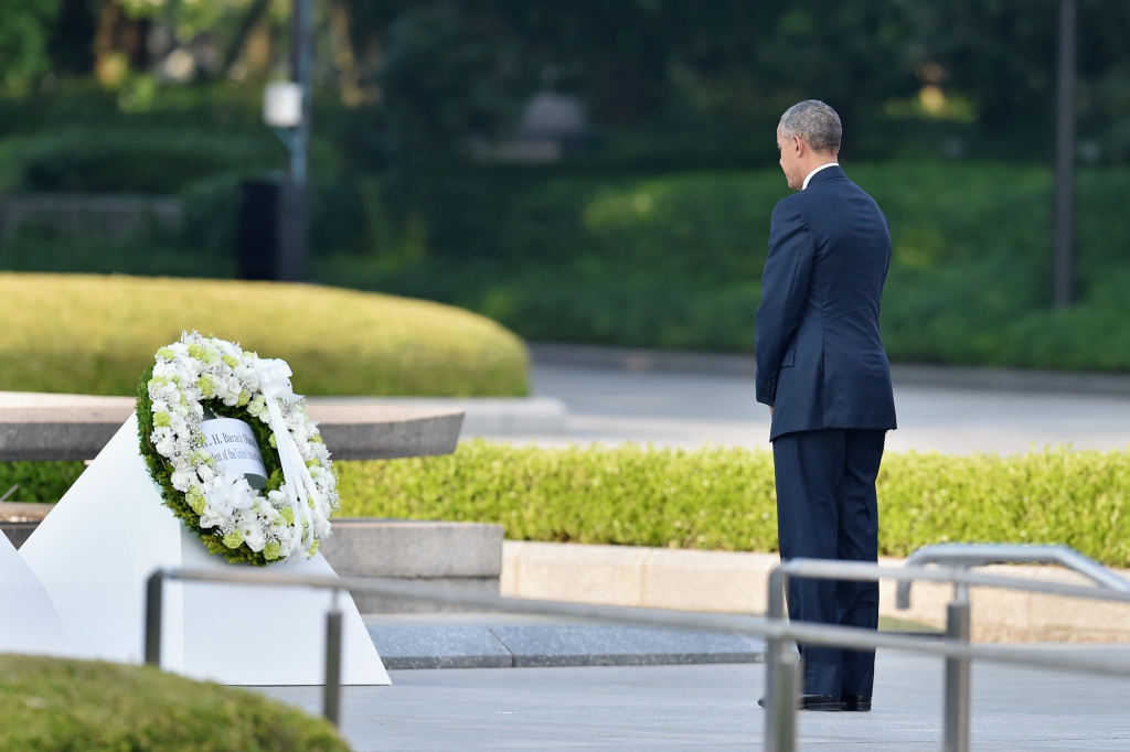 HIROSHIMA, JAPAN - MAY 27:  U.S. President Barack Obama gives flowers during his visit to the Hiroshima Peace Memorial Park on May 27, 2016 in Hiroshima, Japan. It is the first time U.S. President makes an official visit to Hiroshima, the site where the atomic bomb was dropped in the end of World War II on August 6, 1945.  (Photo by Atsushi Tomura/Getty Images)