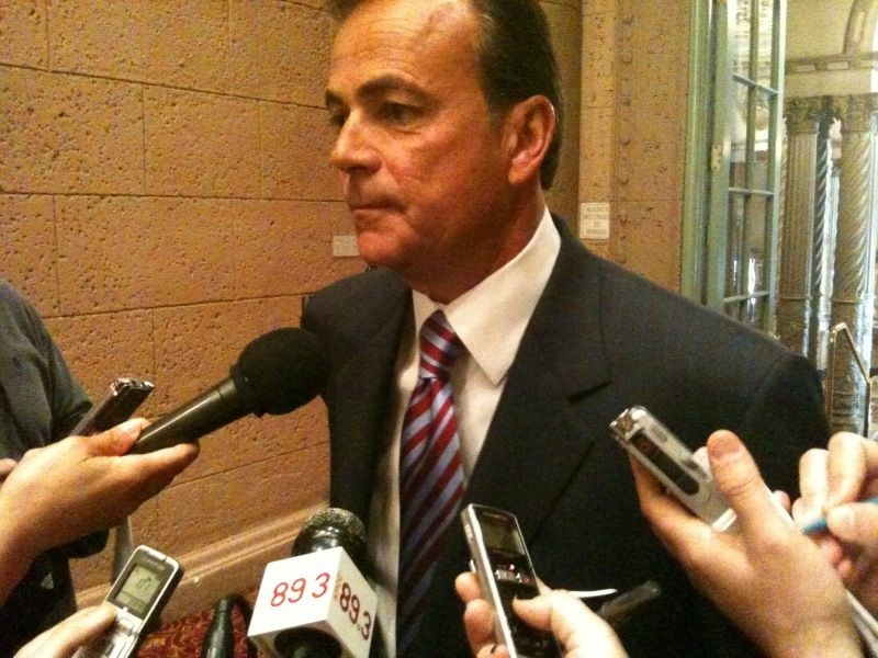Rick Caruso speaks with reporters at the Biltmore Hotel, where he addressed Town Hall Los Angeles.