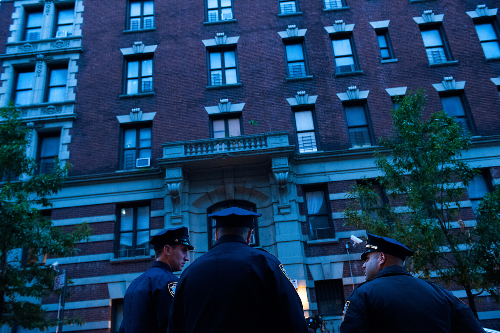 Police officers stand outside 546 W. 147th street, the apartment building of Dr. Craig Spencer, Oct. 23, 2014 in New York City. After returning to New York City from Guinea where he was working with Doctors Without Borders treating Ebola patients, Spencer was quarantined after showing symptoms consistent with the virus. Spencer was taken to Bellevue hospital to undergo testing.