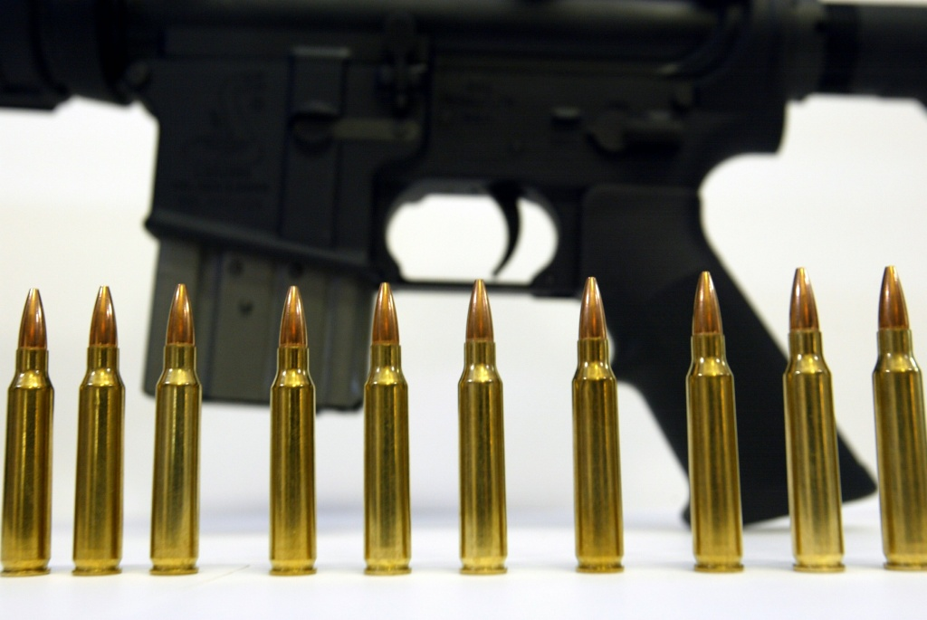 Several .223 caliber rounds are shown near a Bushmaster XM-15 October 25, 2002 in Hollywood, Florida. A Los Angeles County deputy has pleaded guilty to building a .223-caliber rifle.