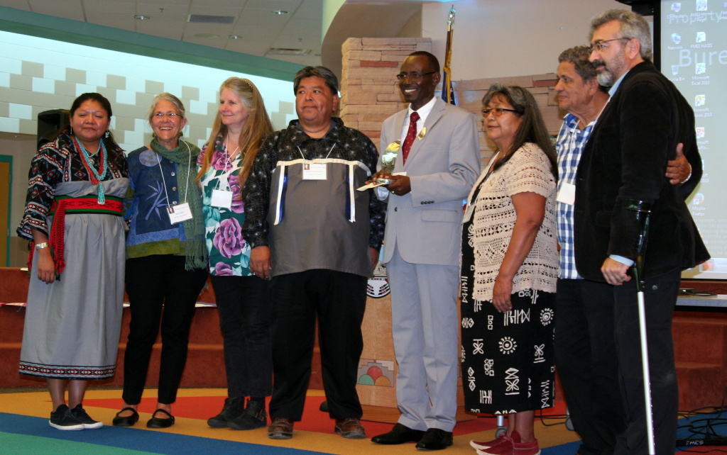 The Barbara Chester Award, given by the Hopi Foundation, honors those who work with torture victims. From l to r: Monica Nuvamsa, Hopi Foundation Director; previous Barbara Chester Award recipients Dr. Mary Fabri (2009) and Shari Eppel (2000); Hopi silversmith Floyd Lomakuyvaya, creator of the silver eagle feather sculpture given to honorees; Dr. Nassoon Munyandamutsa, 2013 recipient of the Barbara Chester Award; Beatrice Norton, Chairperson of the Hopi Foundation Board; and previous award recipients Dr. Juan Almendares (2001), and Dr. Alp Ayan (2006).