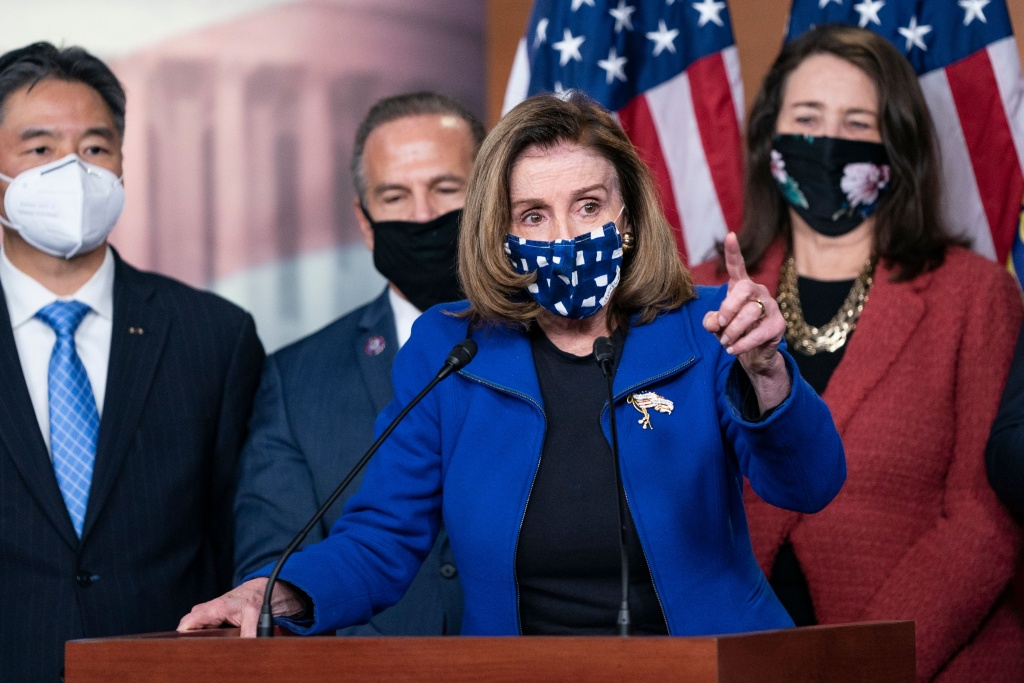 US Speaker of the House Nancy Pelosi, with House impeachment managers, speaks to the press after the Senate voted to acquit former US President Donald Trump, in the US Capitol in Washington, DC, on February 13, 2021.